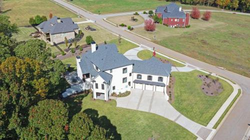 CUSTOM HOME BUILD-print-064-065-Aerial-4200x2363-300dpi