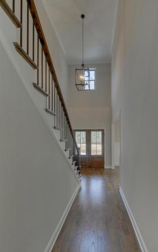 Hardwood Flooring | North Georgia New Home Construction | Open Stair Case | Wrought Iron Balusters