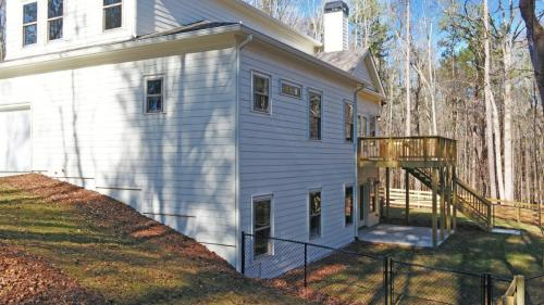 All White Siding Exterior | Two-Story White Modern Farmhouse | North Georgia New Home Construction | Covered Patio | Large Sundeck.